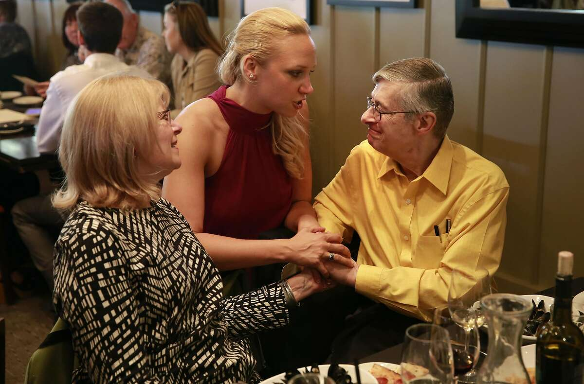Jillian Sobol and her adoptive parents, Helene and Sam Sobol, celebrate during lunch ahead of her graduation from S.F. State.