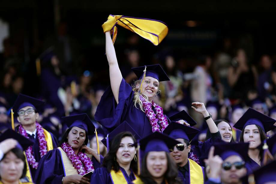 Jillian Sobol celebrates during the graduation ceremony at San Francisco State University. Photo: Michael Macor, The Chronicle