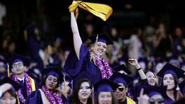 Jillian Sobol show her excitement during her college graduation ceremony at AT&T Park on Fri. May 27, 2016, in San Francisco , California. Sobol was found abandoned as a baby in 1984 on the campus San Francisco State University.