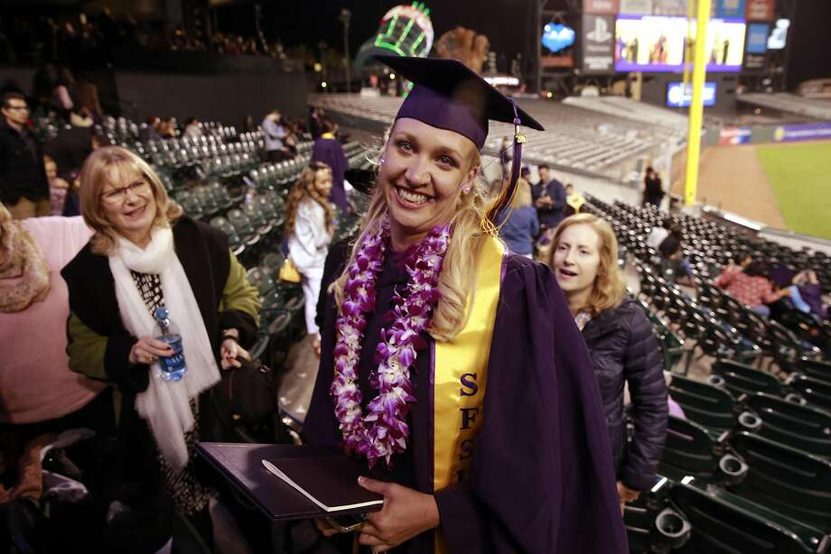 Jillian Sobol graduates from SFSU during a ceremony at AT&T Park on Fri. May 27, 2016, in San Francisco , California. Sobol was found abandoned as a baby in 1984 on the campus San Francisco State University. Photo: Michael Macor, The Chronicle