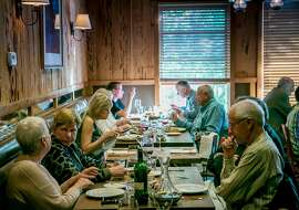 People have dinner in the Western Room at Rancho Nicasio in Nicasio, Calif., on May 27th, 2016.