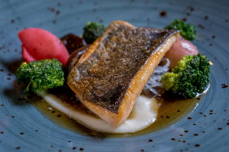 Mount Lassen Trout is served on daikon, carrots and broccoli florets in a pool of dashi broth. Photo: John Storey, Special To The Chronicle