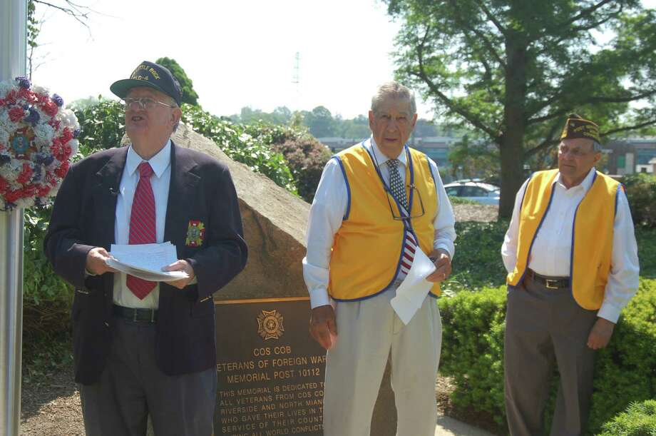From left Cos Cob VFW Post 8 members Bill Cameron, Lou Caravella and Tony Marzullo took part in the Saturday morning Memorial Day ceremony before a crowd of close to 50. Photo: / Ken Borsuk