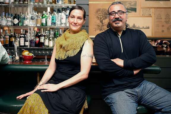 Bar manager Valen West (left) sits at the bar with chef Hoss Zare (right) at Fly Trap on Friday, May 27, 2016 in San Francisco, Calif.