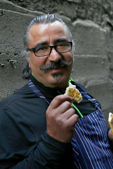Owner/chef Hoss Zare with a piece of Barbari from Tabriz at Fly Trap on Friday, May 27, 2016 in San Francisco, Calif. Photo: Liz Hafalia, The Chronicle