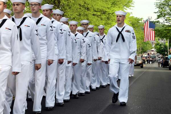 Petty officer first class Robert Poirier, right, and a detail from the Naval Nuclear Power Training Unit march in the Memorial Day Parade down Milton Avenue Saturday May 28, 2016 in Ballston Spa, NY.  (John Carl D'Annibale / Times Union)