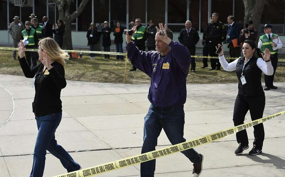 Actors leave the scene of a active shooter drill at the Voorheesville High School March 24, 2016 in Voorheesville, N.Y.  (Skip Dickstein/Times Union) Photo: SKIP DICKSTEIN, ALBANY TIMES UNION