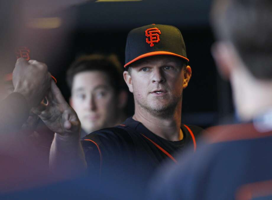 San Francisco Giants pitcher Matt Cain is greeted in the dugout after the sixth inning during a baseball game against the Chicago Cubs, Saturday, May 21, 2016, in San Francisco. Photo: George Nikitin, Associated Press