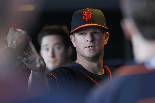 San Francisco Giants pitcher Matt Cain is greeted in the dugout after the sixth inning during a baseball game against the Chicago Cubs, Saturday, May 21, 2016, in San Francisco. (AP Photo/George Nikitin)