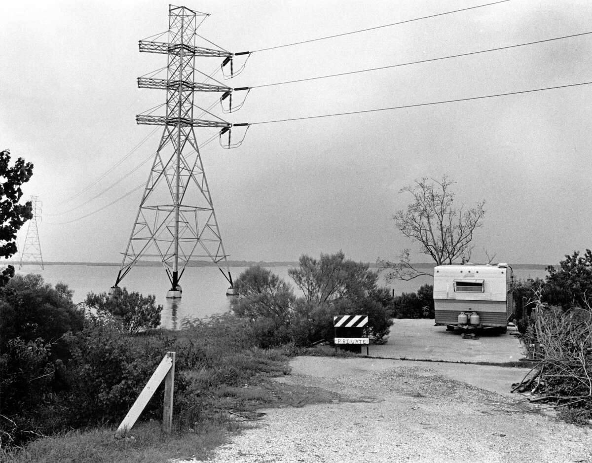 08/10/1979 - The waters off this point of land in the subsiding Brownwood Subdivision in Baytown are the proposed site for a barge terminal. Several residents object to the project that attorney George Chandler plans to build fearing it will pollute the bay and reduce the value of their properties.