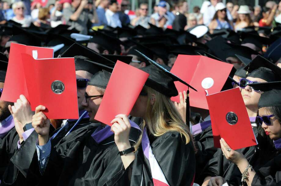 Graduates shield their eyes from the sun using programs during Rensselaer Polytechnic Institute's 210th Commencement at the East Campus Athletic Village Stadium on Saturday May 28, 2016 in Troy, N.Y. (Michael P. Farrell/Times Union) Photo: Michael P. Farrell / 10036368A