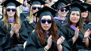 Graduates apllaud the graduate address by Ertharin Cousin, , Executive Director of the United Nations World Food Programme, during Rensselaer Polytechnic Institute's 210th Commencement at the East Campus Athletic Village Stadium on Saturday May 28, 2016 in Troy, N.Y. (Michael P. Farrell/Times Union)