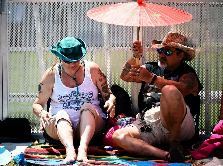 Kimberly and Gypsy Munoz of Vallejo seek shade before the opening performance at Bottle Rock 2016 in Napa, Calif. on Saturday, May 28, 2016. Photo: Michael Noble Jr., The Chronicle