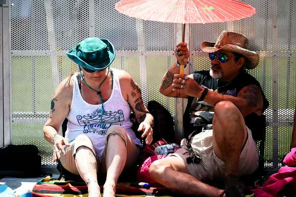 Kimberly and Gypsy Munoz of Vallejo seek shade before the opening performance at Bottle Rock 2016 in Napa, Calif. on Saturday, May 28, 2016.