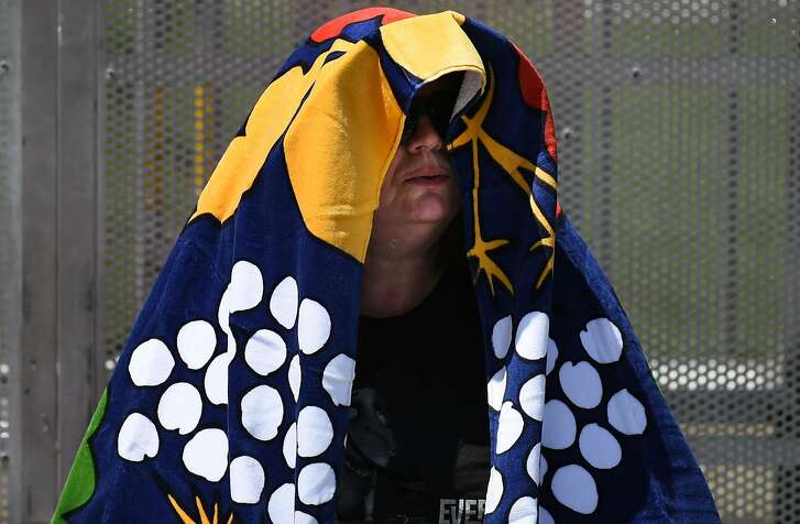 Rosie Moffitt of Bolder Creek uses a blanket to stay out of the sun at  Bottle Rock 2016 in Napa, Calif. on Saturday, May 28, 2016.