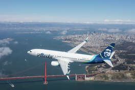 A shot from Alaska Airlines' new Boeing 737-900ER aircraft commercial filmed in partly cloudy skies of the Bay Area Wednesday.