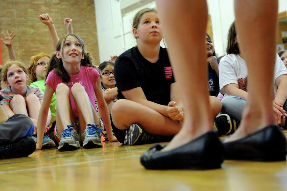 Tera Moody of Boulder, Colo., right, talks with fourth graders on Wednesday, May 29, 2013, at Westmere Elementary in Guilderland, N.Y. Moody will run in the Freihofer's Run for Women on Saturday. (Cindy Schultz / Times Union) Photo: Cindy Schultz / 00022613A