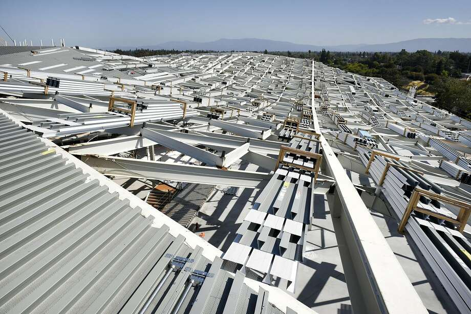 The undulating roof of NVIDIA's new, under construction building is said to mimic the rolling hills surrounding the area, in Santa Clara, CA Friday, May 27th, 2016. The futuristic triangle shaped building was designed by architects are using NVIDIA's own 3D rendering Iray virtual reality technology. Photo: Michael Short, Special To The Chronicle