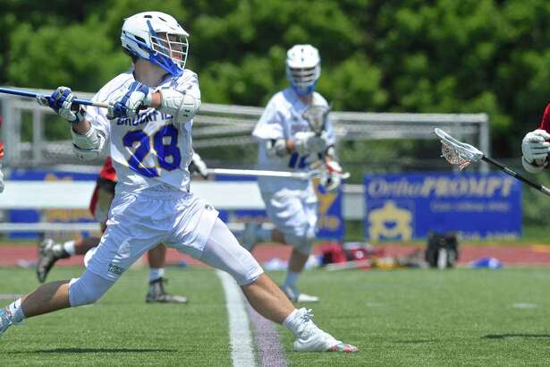 Brookfield's Dane Borges (28) takes a shot on goal in the state class M boys lacrosse game against Stratford Saturday at Brookfield High School. The Bobcats won 16-8.