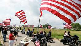 People stand with Flags on the road as the bikers enter the Home. Participating motorcycle organizations are Sovereign Sons of San Antonio MC, Combat Vets Chapter 23-3 and Auxiliary, Soldiers for Jesus MC, Fallen Saints MC of San Antonio, Patriot Guard Riders, Air Force Sergeants Association, Combat Vets Association and the Green Knights. We anticipate more than 500 people will attend this event to honor our local veterans at Frank M. Tejeda Texas State Veterans Home in Floresville on Saturday, May 28,