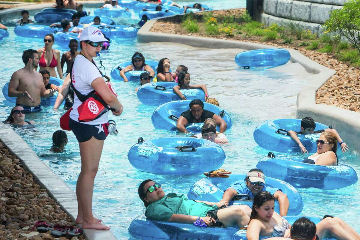 Visitors to Typhoon Texas water park float along the