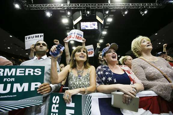Supporters listen as Republican presidential candidate Donald Trump speaks during a rally, Friday, May 27, 2016 in Fresno, Calif. (AP Photo/Chris Carlson)