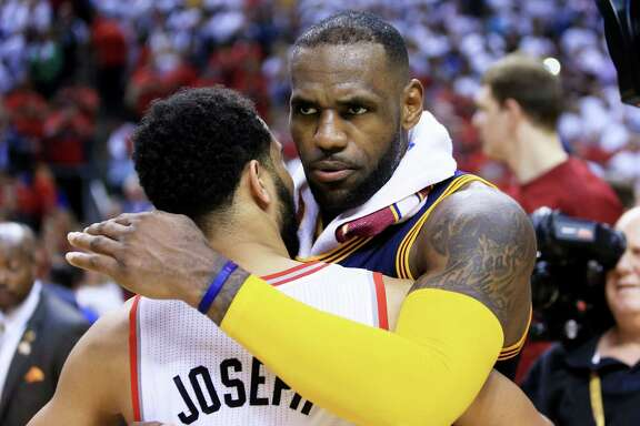 TORONTO, ON - MAY 27:  LeBron James #23 of the Cleveland Cavaliers embraces Cory Joseph #6 of the Toronto Raptors after the Cleveland Cavaliers defeated the Toronto Raptors 113 to 87 in game six of the Eastern Conference Finals during the 2016 NBA Playoffs at Air Canada Centre on May 27, 2016 in Toronto, Canada. NOTE TO USER: User expressly acknowledges and agrees that, by downloading and or using this photograph, User is consenting to the terms and conditions of the Getty Images License Agreement.  (Photo by Vaughn Ridley/Getty Images)