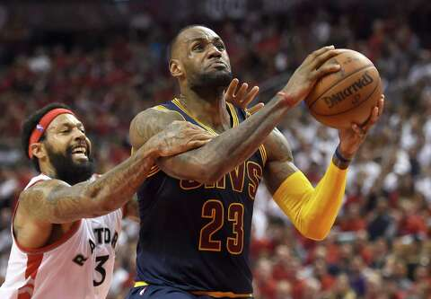 b38048e38fdd Toronto Raptors forward James Johnson fouls Cleveland Cavaliers forward  LeBron James late in the fourth quarter