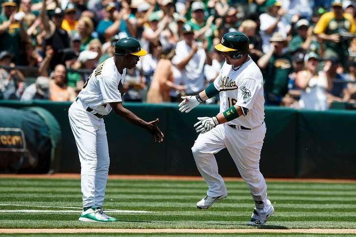 OAKLAND, CA - MAY 28: Billy Butler #16 of the Oakland Athletics is congratulated by third base coach Ron Washington #38 after hitting a home run against the Detroit Tigers during the second inning at the Oakland Coliseum on May 28, 2016 in Oakland, California. (Photo by Jason O. Watson/Getty Images)