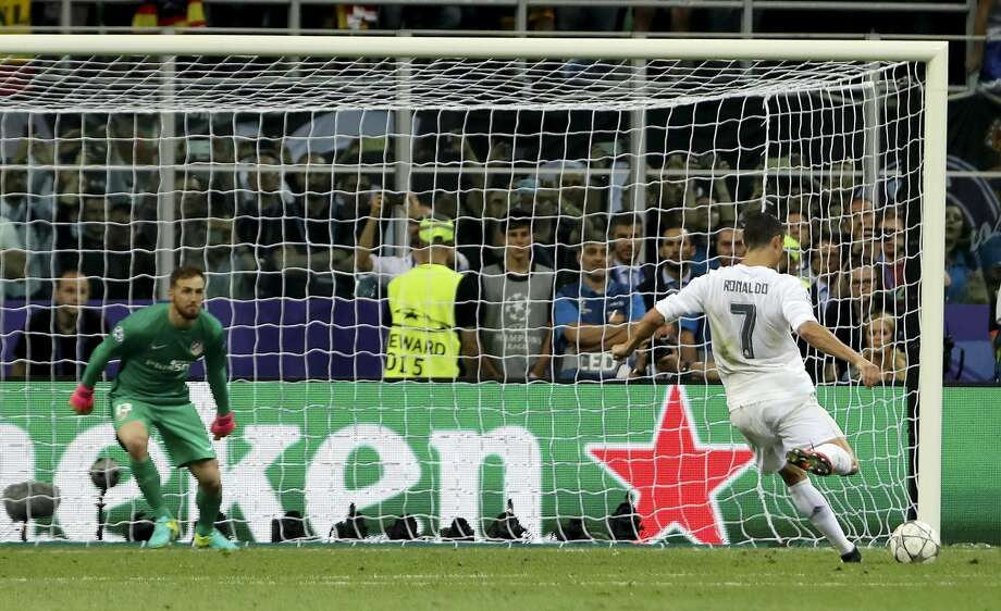 Real Madrid's Cristiano Ronaldo scores the decisive penalty kick to win the Champions League. Photo: Luca Bruno, Associated Press