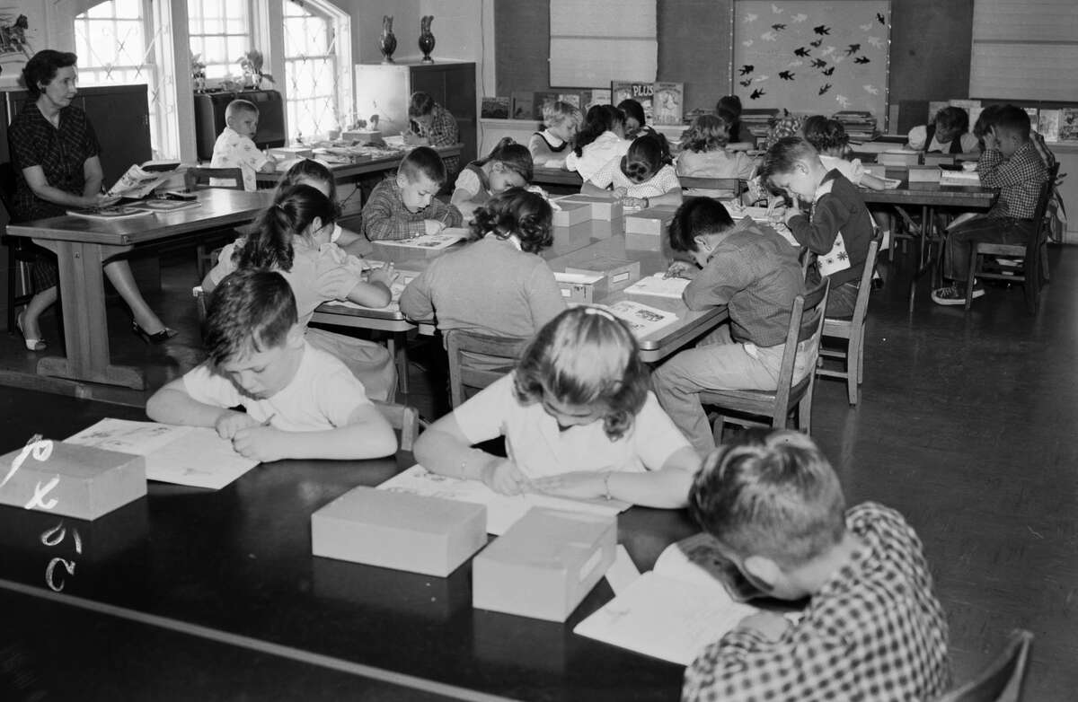 """Students at St. Mark's school in 1959 are said to have studied """"a public school curriculum"""" in the preschool and elementary school sponsored by St. Mark's Episcopal Church."""