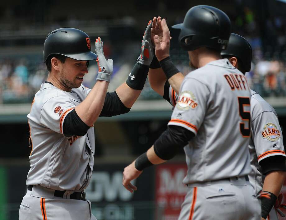 DENVER, CO - MAY 28:  Buster Posey #28 of the San Francisco Giants is congratulated by team mates against the Colorado Rockies at Coors Field on May 28, 2016 in Denver, Colorado. Photo: Bart Young, Getty Images