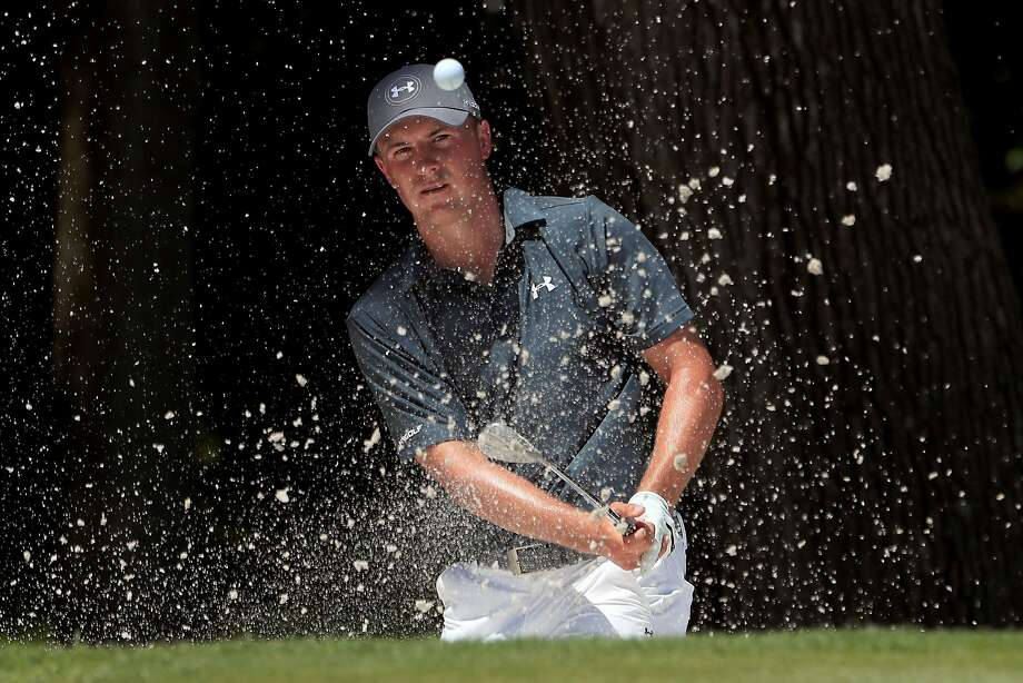 Jordan Spieth hits a shot out of the bunker on No. 8. Photo: Tom Pennington, Getty Images