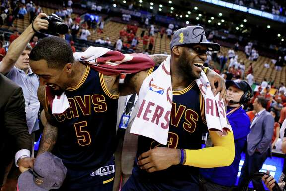 J.R. Smith, left, and LeBron James whoop it up after the Cavaliers bested the Raptors for the Eastern Confer-ence title. It's on to the NBA Finals as Cleveland seeks to end a 52-year title drought for the city's sports fans.