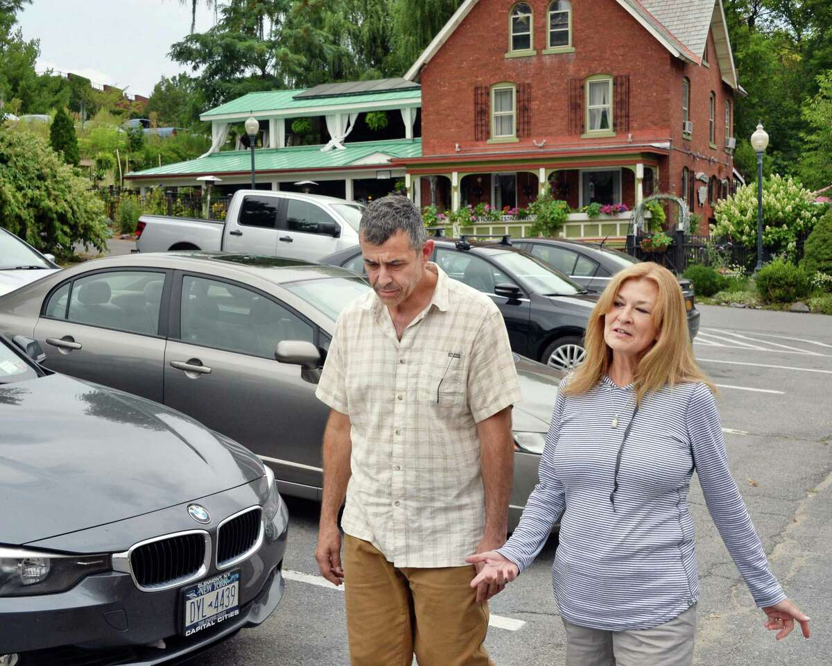 David and Dianne Pedinotti, husband and wife co-owners of the Mouzon House walk through the existing parking lot outside their restaurant Thursday Sept. 10, 2015 in Saratoga Springs, NY. They are in a legal battle to stop the proposed city center's high-rise garage from being built next to their restaurant. (John Carl D'Annibale / Times Union archive)