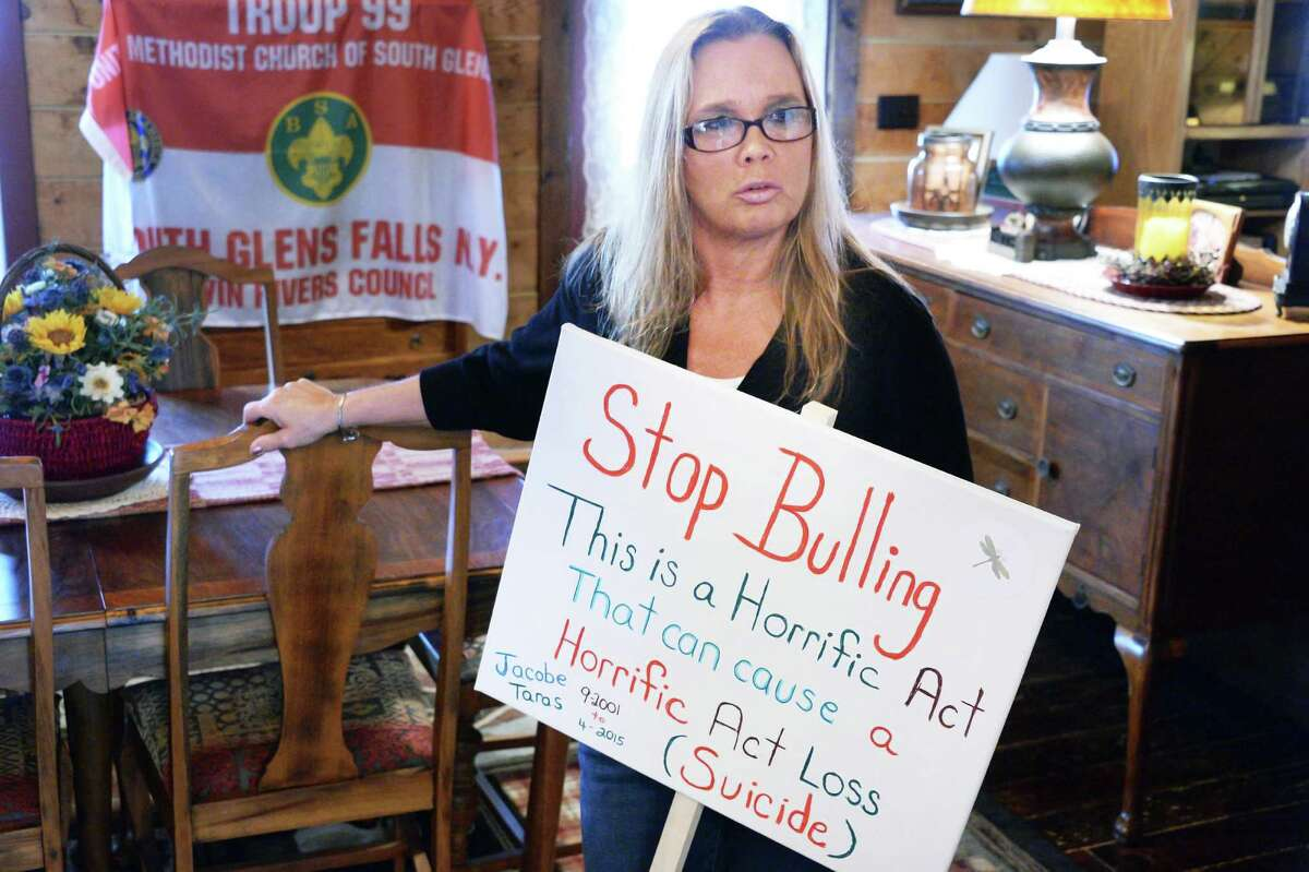 Christine Taras holds a Stop Bullying sign during an interview at her home Friday, May 6, 2016, in Fort Edward, N.Y. Her son Jacobe Skyler Taras killed himself at the age of 12. (John Carl D'Annibale / Times Union)