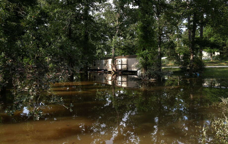 A flooded home is seen at the corner of Rock Elm Lane and Kingbird Drive, Saturday, May 28, 2016, in Tomball. Photo: Jon Shapley, Houston Chronicle / © 2015  Houston Chronicle