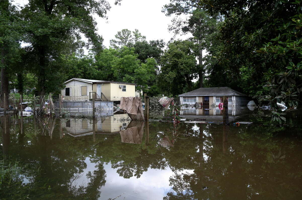 A flooded home is seen at the corner of Rock Elm Lane and Kingbird Drive, Saturday, May 28, 2016, in Tomball.