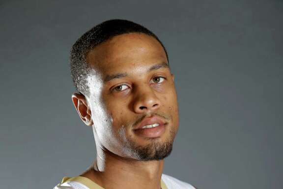 FILE - In this 2015, file photo, New Orleans Pelicans guard Bryce Dejean-Jones (31) poses during their NBA basketball media day in Metairie, La. Police say Saturday, May 28, 2016,  Dejean-Jones was fatally shot after breaking down the door to a Dallas apartment. Sr. Cpl. DeMarquis Black said in a statement that officers were called early Saturday morning and found the 23-year-old player collapsed in an outdoor passageway. He was taken to a hospital where he died.  (AP Photo/Gerald Herbert, File)