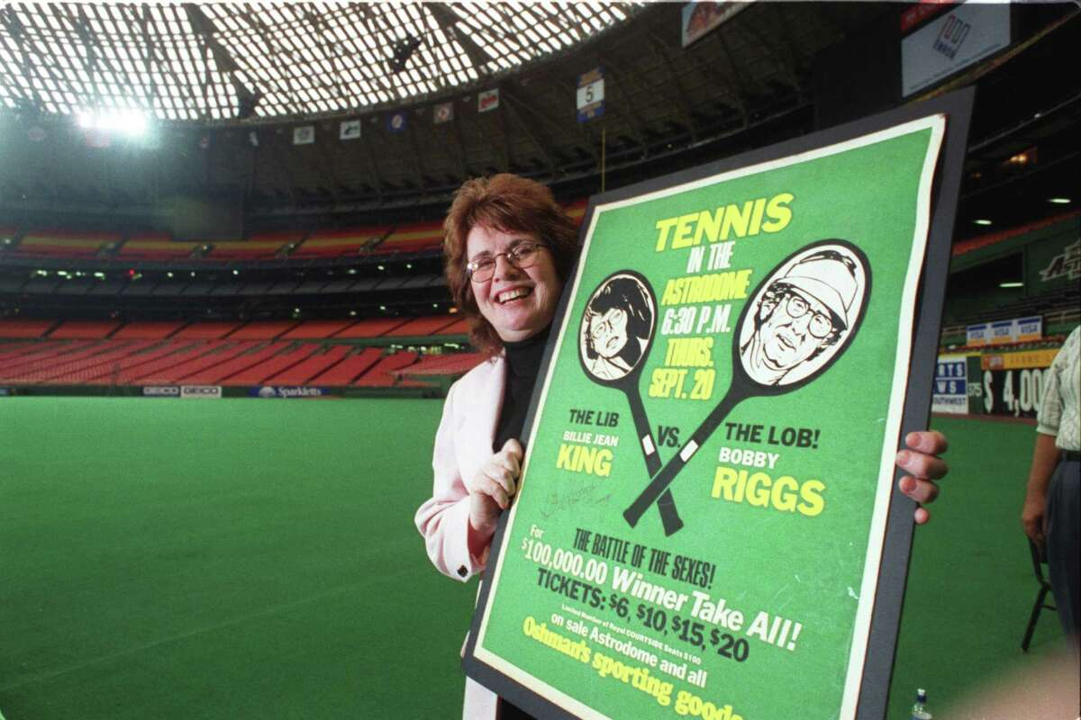 1998: Billie Jean King shows off a poster for the 'Battle of the Sexes,' her historic match against Bobby Riggs held in the Astrodome.