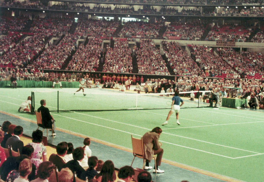 PHOTOS: A battle of the sexes at the Astrodome Bobby Riggs, right, goes after a quick shot by Billie Jean King in the winner-take-all tennis match in the Astrodome in Houston on Sept. 20, 1973.  >>>See more photos from the historic match... Photo: STR / AP