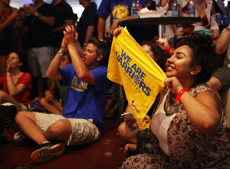Festival goers watch the NBA Conference Finals against Oklahoma City Thunder at the Bottle Rock 2016 festival in Napa, Calif. on Saturday, May 28, 2016. Photo: Michael Noble, The Chronicle