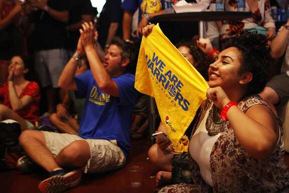 Festival goers watch the NBA Conference Finals against Oklahoma City Thunder at the Bottle Rock 2016 festival in Napa, Calif. on Saturday, May 28, 2016.