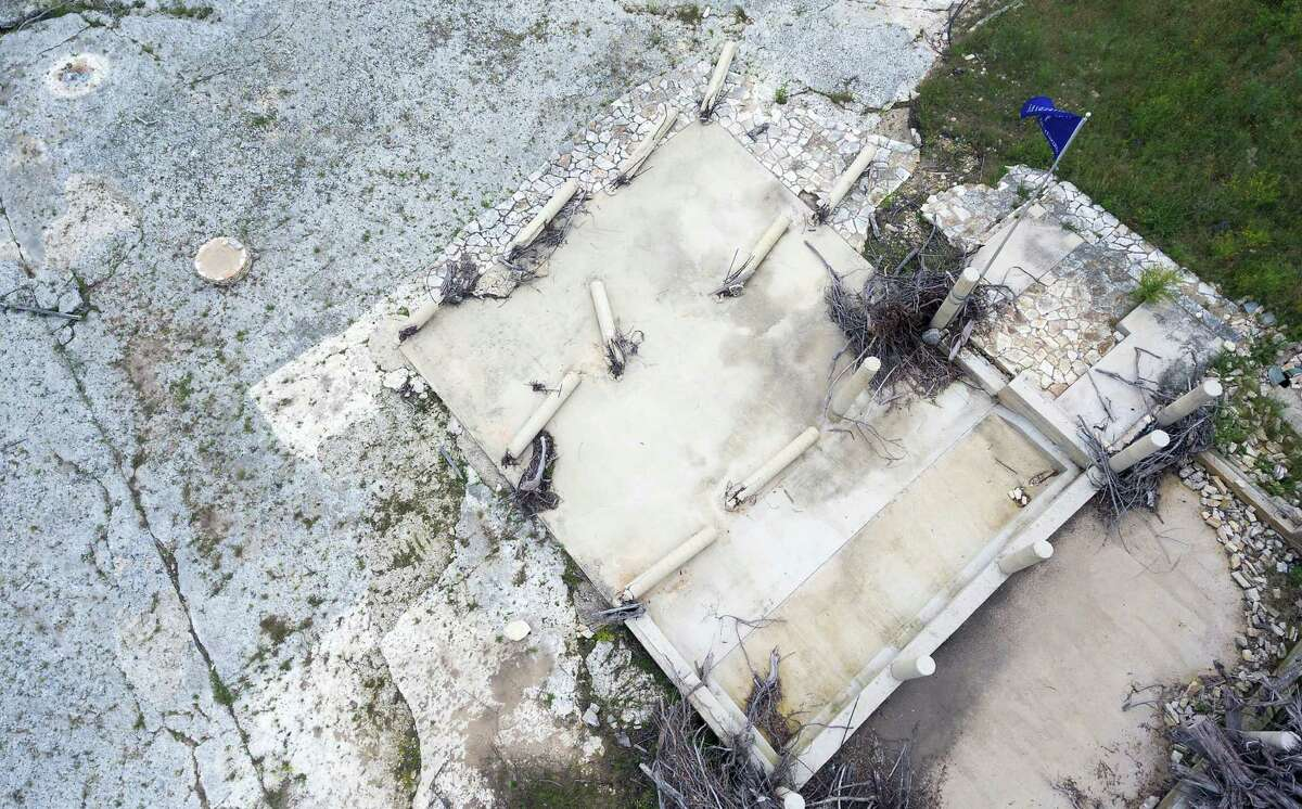 The foundation of the vacation home where the McComb family was staying when Memorial Day 2015 flooding swept the structure into the water is seen in a May 25, 2016 aerial image made with a remote controlled quadcopter. Laura, son, Andrew, 7, and daughter, Leighton, 4, were all killed when flood waters swept the home off its foundation. Only husband and father, Jonathan, survived the ordeal.