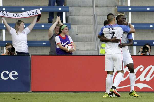 U.S. forward Gyasi Zardes, right, is congratulated by forward Bobby Wood (7) after scoring during the first half of an international friendly soccer match against Bolivia, Saturday, May. 28, 2016, in Kansas City, Kan. (AP Photo/Colin E. Braley)