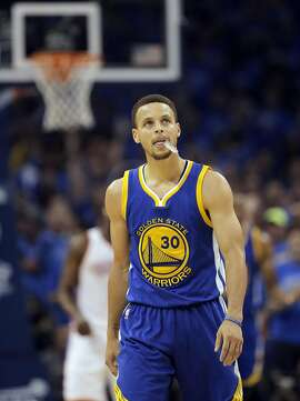 Stephen Curry (30) looks up at the crowd in the first half as the Golden State Warriors played the Oklahoma City Thunder in Game 6 of the Western Conference Finals at Chesapeake Energy Arena in Oklahoma City, Okla., on Saturday, May 28, 2016.