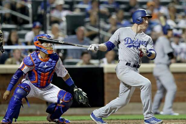 NEW YORK, NY - MAY 28:  Chase Utley #26 of the Los Angeles Dodgers hits a grand slam as Rene Rivera #44 of the New York Mets defends in the seventh inning at Citi Field on May 28, 2016 in the Flushing neighborhood of the Queens borough of New York City.  (Photo by Elsa/Getty Images) ORG XMIT: 607678455