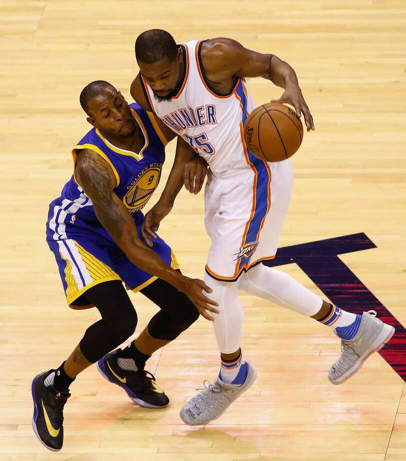 OKLAHOMA CITY, OK - MAY 28:  Kevin Durant #35 of the Oklahoma City Thunder drives against Andre Iguodala #9 of the Golden State Warriors during the first half in game six of the Western Conference Finals during the 2016 NBA Playoffs at Chesapeake Energy Arena on May 28, 2016 in Oklahoma City, Oklahoma. NOTE TO USER: User expressly acknowledges and agrees that, by downloading and or using this photograph, User is consenting to the terms and conditions of the Getty Images License Agreement.  (Photo by J Pat Carter/Getty Images) Photo: J Pat Carter, Getty Images