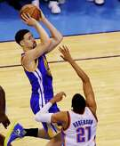 Golden State Warriors guard Klay Thompson (11) shoots over Oklahoma City Thunder guard Andre Roberson (21) during the first half in Game 6 of the NBA basketball Western Conference Finals in Oklahoma City, Saturday, May 28, 2016.