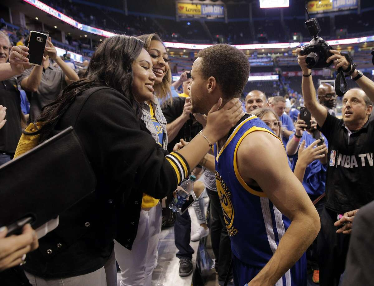 Stephen Curry (30) leans in to kiss his wife Ayesha Curry after the Golden State Warriors defeated the Oklahoma City Thunder 106-101 in Game 6 of the Western Conference Finals at Chesapeake Energy Arena in Oklahoma City, Okla., on Saturday, May 28, 2016.